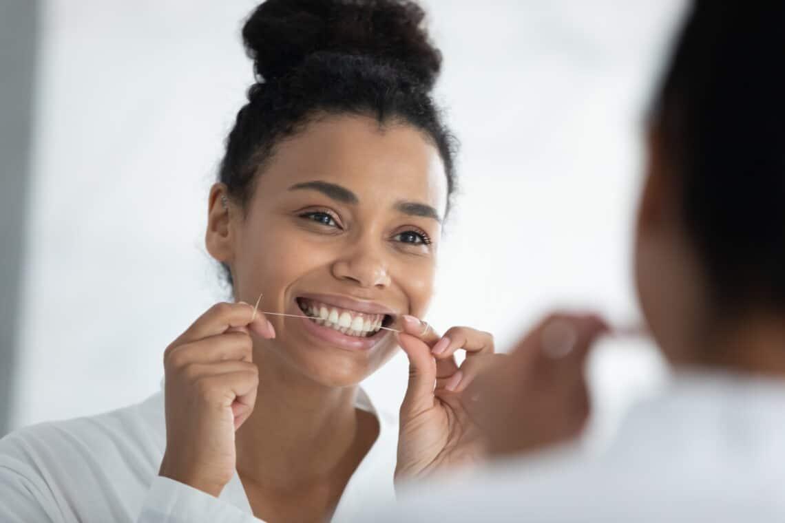 Women cleaning teeth