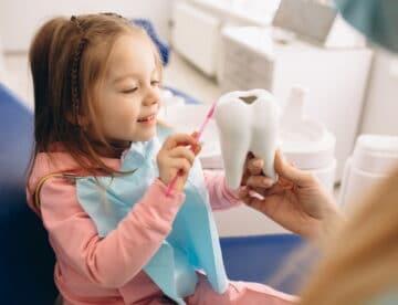Little girl at pediatric dentist