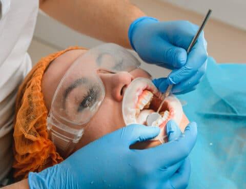 dentist working on full mouth rehabilitation