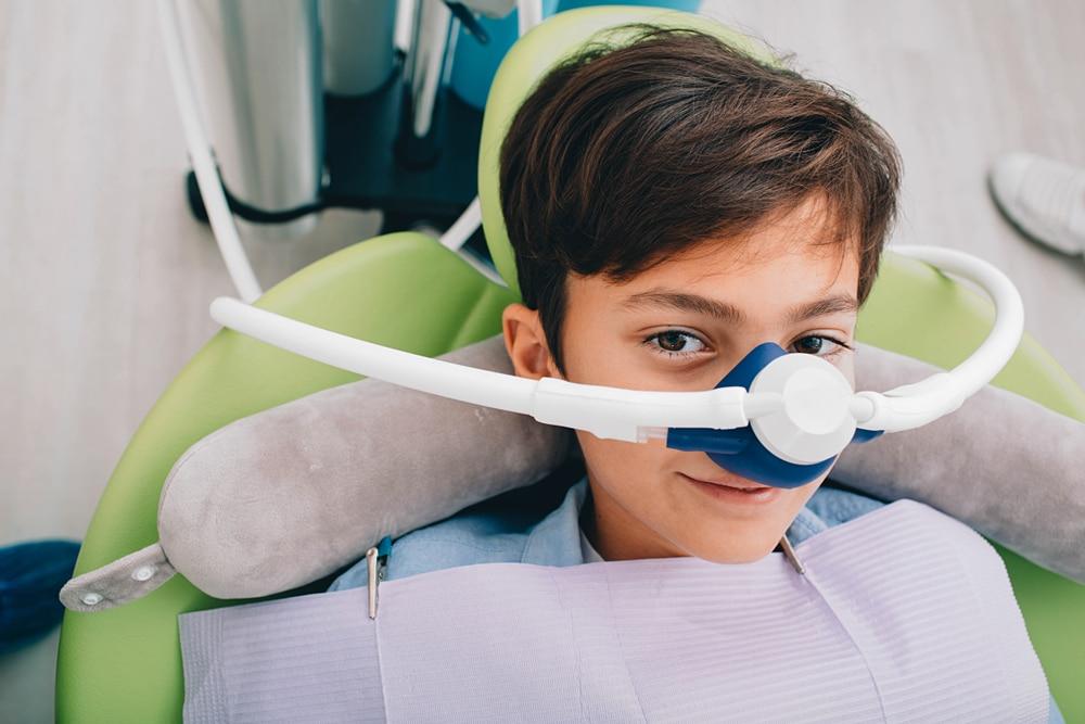 Little,Boy,Getting,Inhalation,Sedation,While,Teeth,Treatment,At,Dental